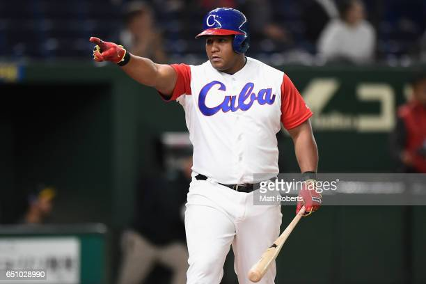 Outfielder Alfredo Despaigne of Cuba celebrates after hitting a grand slam to make it 14 in the bottom of the fifth inning during the World Baseball...