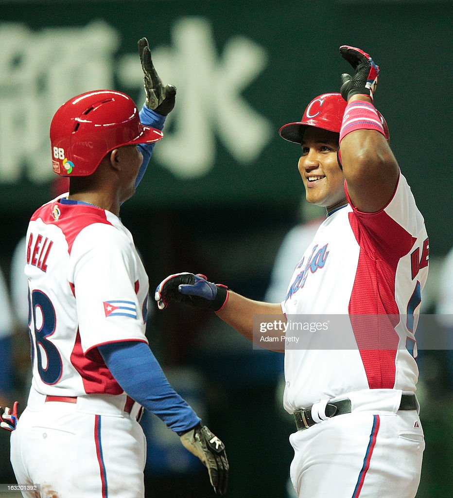 Outfielder Alfredo Despaigne #54 of Cuba celebrates after hitting a home run during the World Baseball Classic First Round Group A game between Japan and Cuba at Fukuoka Yahoo! Japan Dome on March 6, 2013 in Fukuoka, Japan.