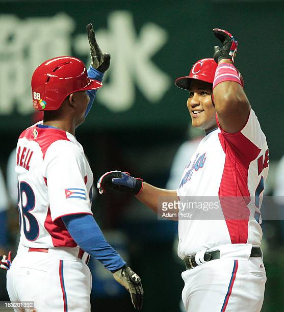 Outfielder Alfredo Despaigne of Cuba celebrates after hitting a home run during the World Baseball Classic First Round Group A game between Japan and...