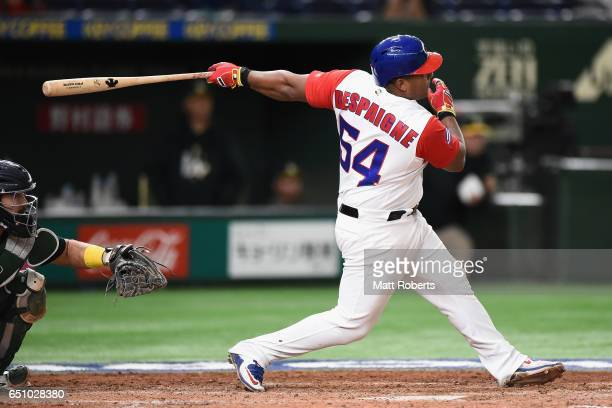Outfielder Alfredo Despaigne of Cuba hits a grand slam to make it 14 in the bottom of the fifth inning during the World Baseball Classic Pool B Game...