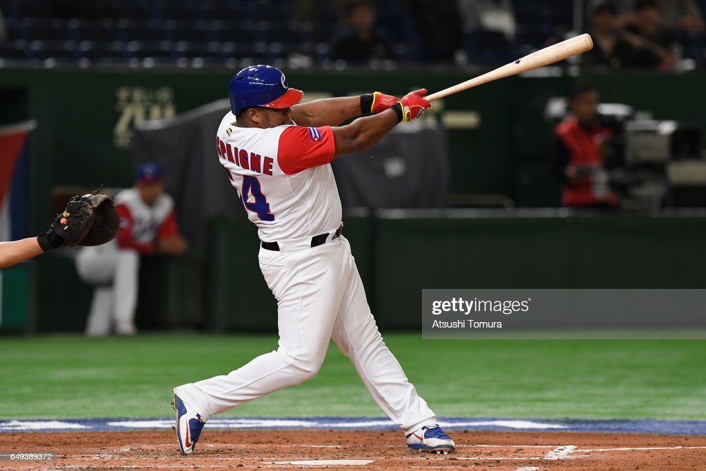Outfielder Alfredo Despaigne #54 of Cuba hits a single in the bottom of the third inning during the World Baseball Classic Pool B Game Two between China and Cuba at Tokyo Dome on March 8, 2017 in Tokyo, Japan.