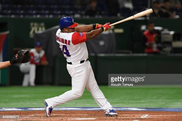 Outfielder Alfredo Despaigne of Cuba hits a single in the bottom of the third inning during the World Baseball Classic Pool B Game Two between China...