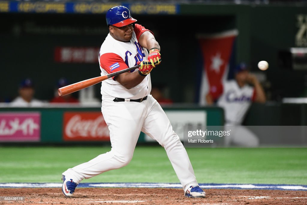 Outfielder Alfredo Despaigne #54 of Cuba hits a single in the bottom of the fourth inning during the World Baseball Classic Pool E Game Five between Netherlands and Cuba at the Tokyo Dome on March 15, 2017 in Tokyo, Japan.