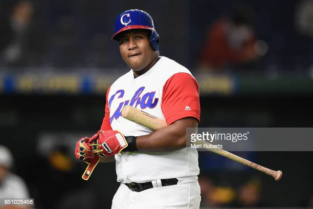 Outfielder Alfredo Despaigne of Cuba reacts after striking out in the bottom of the fourth inning during the World Baseball Classic Pool B Game Five...