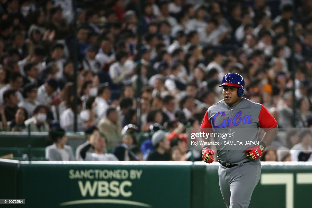 Outfielder Alfredo Despaigne #54 of Cuba runs after hitting a solo homer to make it 2-7 in the top of the seventh inning during the World Baseball Classic Pool B Game One between Cuba and Japan at Tokyo Dome on March 7, 2017 in Tokyo, Japan.