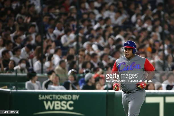 Outfielder Alfredo Despaigne of Cuba runs after hitting a solo homer to make it 27 in the top of the seventh inning during the World Baseball Classic...