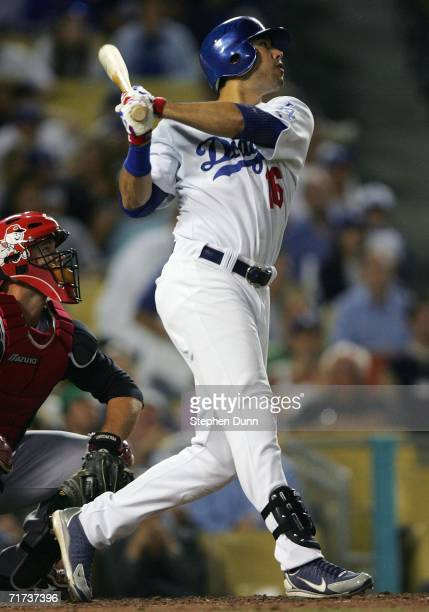 Outfielder Andre Ethier of the Los Angeles Dodgers hits an RBI single during the fourth inning of the game against the Cincinnati Reds at Dodger...