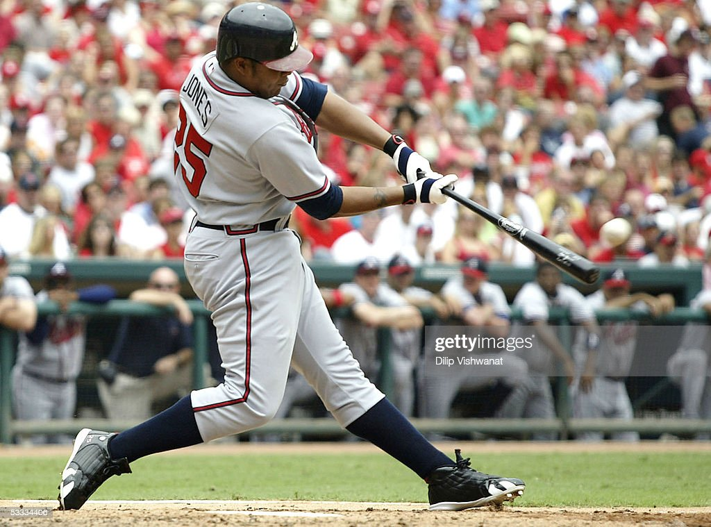 Outfielder Andruw Jones #25 of the Atlanta Braves hits a grand-slam home run against the St. Louis Cardinals on August 6, 2005 at Busch Stadium in St. Louis, Missouri. The Braves defeated the Cardinals 8-1.