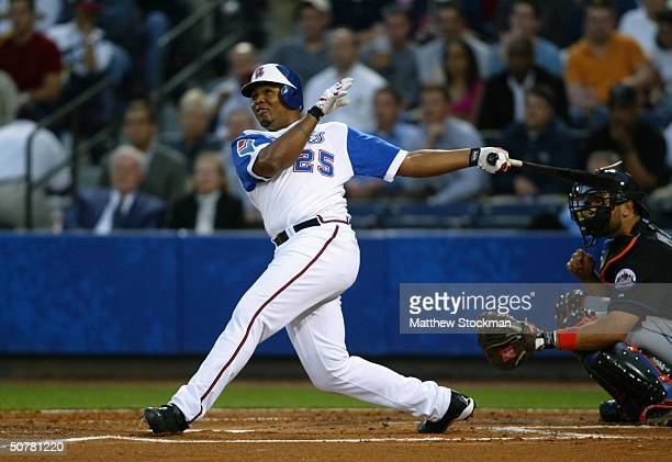 Outfielder Andruw Jones of the Atlanta Braves swings at a New York Mets pitch during the MLB game at Turner Field on April 8 2004 in Atlanta Georgia...