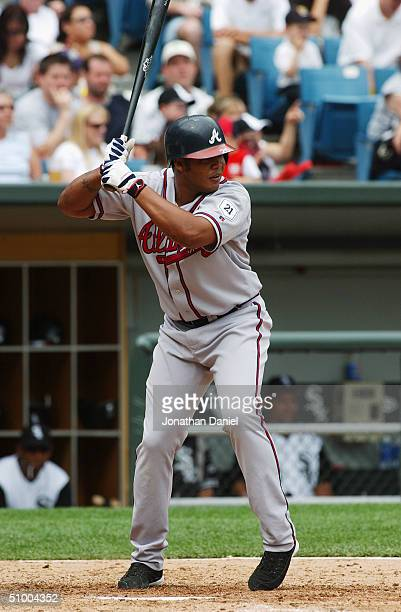 Outfielder Andruw Jones of the Atlanta Braves waits for a Chicago White Sox pitch during a game at US Cellular Field on June 13 2004 in Chicago...