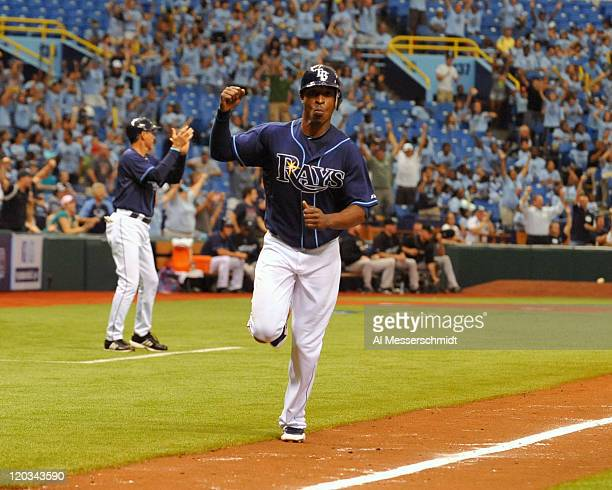 Outfielder B J Upton of the Tampa Bay Rays scores in the 12th inning against the Toronto Blue Jays August 4 2011 at Tropicana Field in St Petersburg...