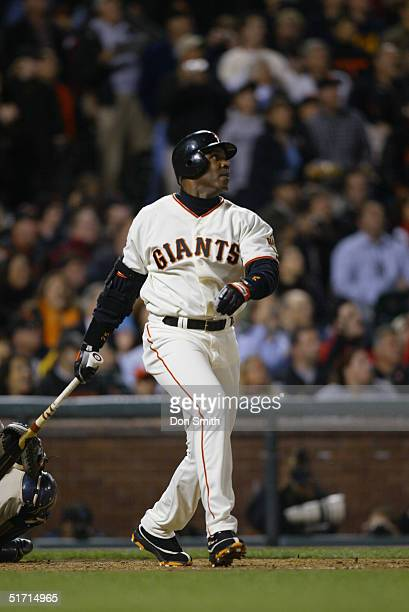 Outfielder Barry Bonds of the San Francisco Giants hits career home run number 700 during the MLB game against the San Diego Padres at SBC Park on...