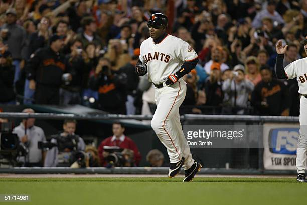 Outfielder Barry Bonds of the San Francisco Giants rounds the bases after hitting career home run number 700 during the MLB game against the San...