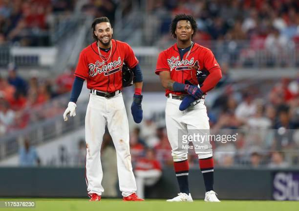Outfielder Billy Hamilton and Ronald Acuna Jr #13 of the Atlanta Braves look on during the game against the Washington Nationals at SunTrust Park on...