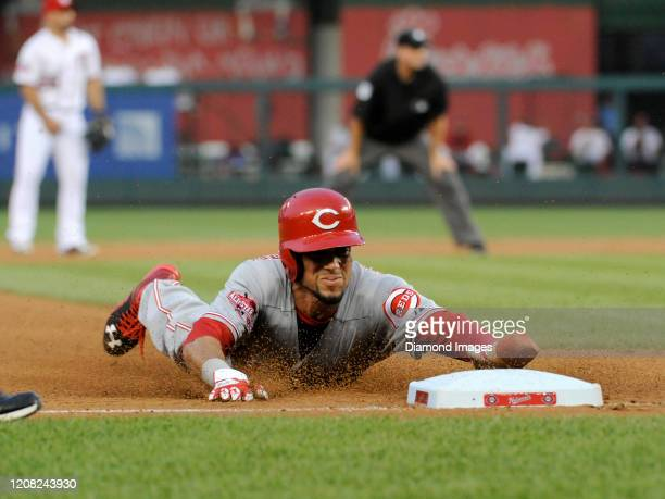 Outfielder Billy Hamilton of the Cincinnati Reds steals thirdbase during the top of the fifth inning of a game on July 7, 2015 against the Washington...