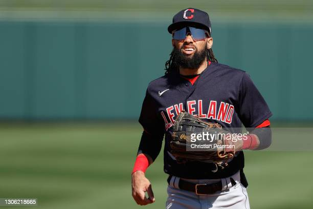Outfielder Billy Hamilton of the Cleveland Indians runs to the dugout during the fifth inning of the MLB spring training game against the Texas...