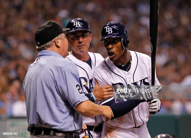Outfielder BJ Upton of the Tampa Bay Rays argues with homeplate umpire Jerry Crawford as third base coach Tom Foley tries to intervene during the...