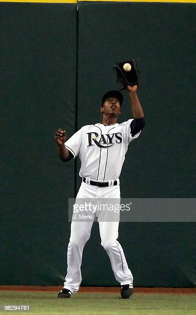 Outfielder BJ Upton of the Tampa Bay Rays catches a fly ball against the Baltimore Orioles during the home opener game at Tropicana Field on April 6...