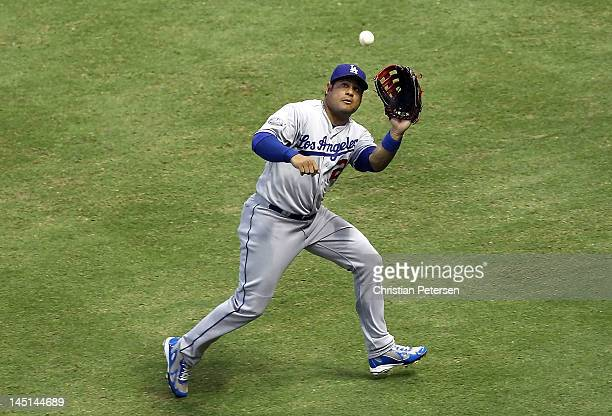 Outfielder Bobby Abreu of the Los Angeles Dodgers catches a fly ball out against the Arizona Diamondbacks during the MLB game at Chase Field on May...