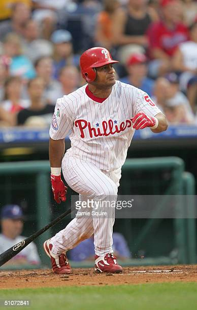 Outfielder Bobby Abreu of the Philadelphia Phillies swings at a Montreal Expos pitch during the game at Citizens Bank Park on July 1, 2004 in...
