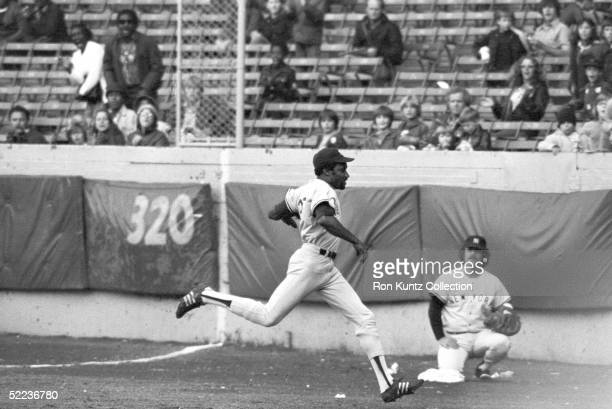 Outfielder Bobby Bonds of the New York Yankees runs to catch a flyball down the rightfield line during a game against the Cleveland Indians on...