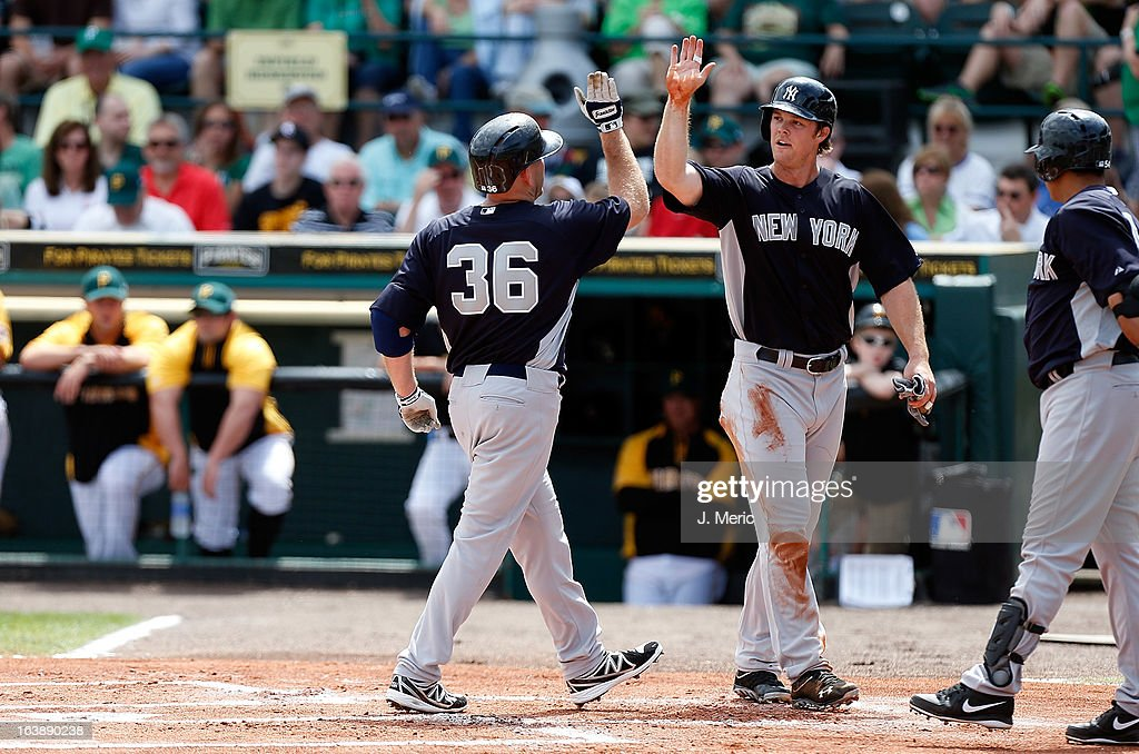 Outfielder Brennan Boesch #58 of the New York Yankees congratulates Kevin Youkilis #36 after his home run against the Pittsburgh Pirates during a Grapefruit League Spring Training Game at McKechnie Field on March 17, 2013 in Bradenton, Florida.