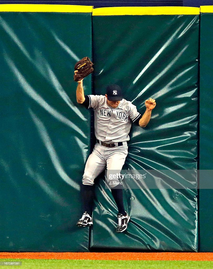 Outfielder Brett Gardner #11 of the New York Yankees catches a fly ball against the centerfield wall during the game against the Tampa Bay Rays at Tropicana Field on April 23, 2013 in St. Petersburg, Florida.