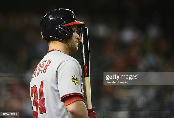 Outfielder Bryce Harper of the Washington Nationals watches from the on deck circle in the game against the Arizona Diamondbacks at Chase Field on...