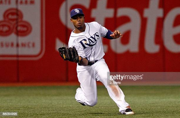 Outfielder Carl Crawford of the Tampa Bay Rays catches a fly ball against the Minnesota Twins during the game at Tropicana Field on May 30 2009 in St...