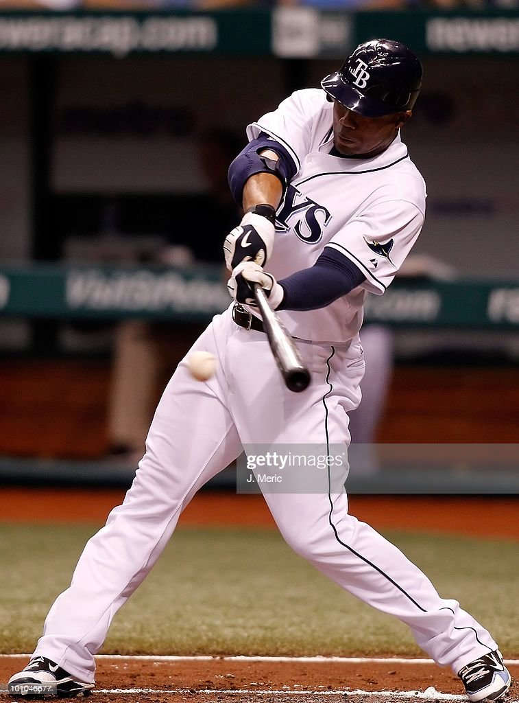 Outfielder Carl Crawford #13 of the Tampa Bay Rays fouls off a pitch against the Seattle Mariners during the game at Tropicana Field on May 14, 2010 in St. Petersburg, Florida.