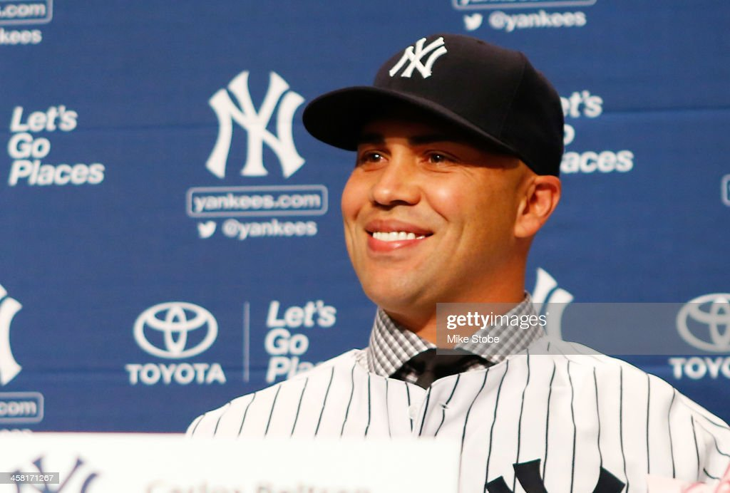 Outfielder Carlos Beltran speaks to the media during his introductory press conference at Yankee Stadium on December 20, 2013 in the Bronx borough of New York City.