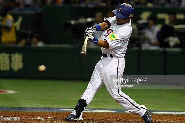 Outfielder ChienMing Chang of Chinese Taipei bats during the World Baseball Classic Second Round Pool 1 game between Japan and Chinese Taipei at...