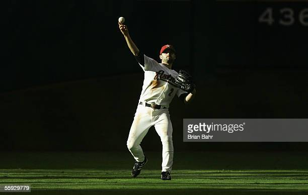 Outfielder Chris Burke of the Houston Astros throws in a single during Game Three of the National League Championship Series against the St Louis...