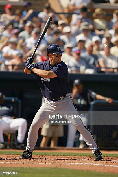 Outfielder Chris Magruder of the Milwaukee Brewers bats during a Spring Training game against the Seattle Mariners on March 7 2005 at Peoria Sports...