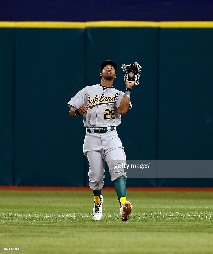 Outfielder Chris Young #25 of the Oakland Athletics catches a fly ball against the Tampa Bay Rays during the game at Tropicana Field on April 21, 2013 in St. Petersburg, Florida.