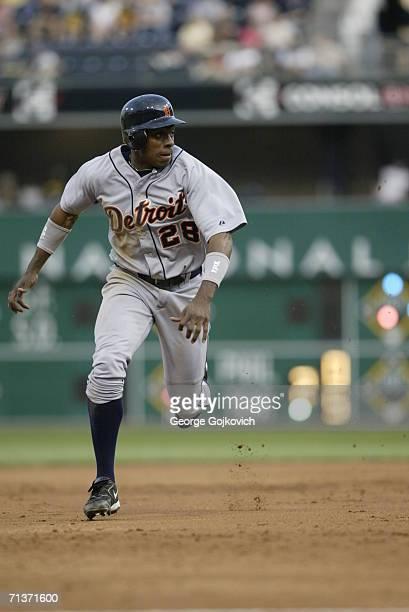 Outfielder Curtis Granderson of the Detroit Tigers runs between second and third base during a game against the Pittsburgh Pirates at PNC Park on...