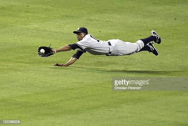 Outfielder Curtis Granderson of the New York Yankees makes a diving catch on the fly ball hit by Chris Young of the Arizona Diamondbacks during the...