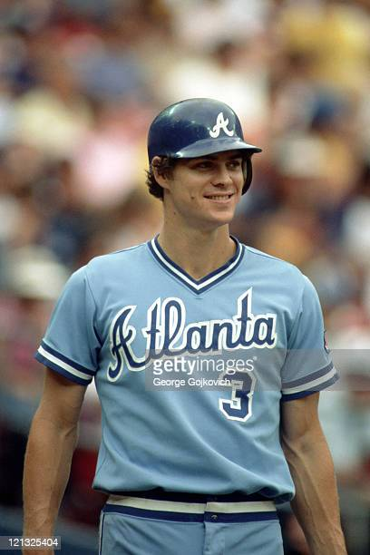 Outfielder Dale Murphy of the Atlanta Braves smiles as he looks on from the field during a game against the Pittsburgh Pirates at Three Rivers...