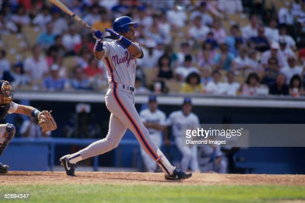 Outfielder Darryl Strawberry of the New York Mets follows through after hitting a pitch during a game in 1987 against the Los Angeles Dodgers at...