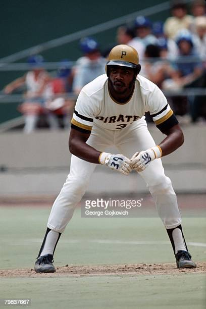 Outfielder Dave Parker of the Pittsburgh Pirates leads off first base during a Major League Baseball game at Three Rivers Stadium circa 1975 in...