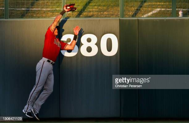 Outfielder David Peralta of the Arizona Diamondbacks makes a leaping catch on a fly ball from Corey Seager of the Los Angeles Dodgers during the...