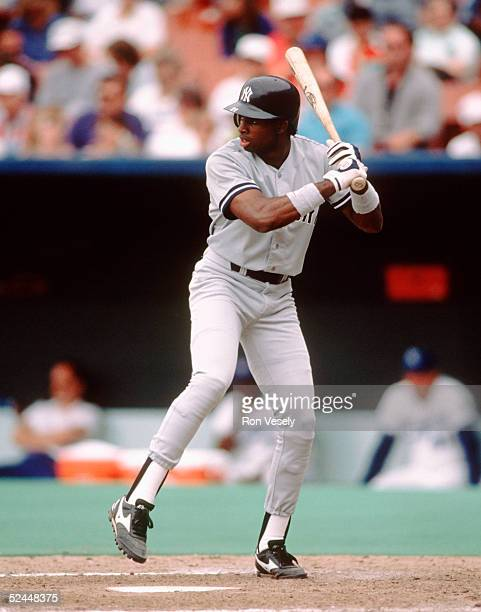 Outfielder Deion Sanders of the New York Yankee steps into the swing during the game against the Kansas City Royals at Kauffman Stadium in Kansas...