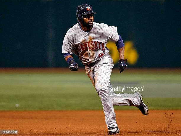 Outfielder Denard Span of the Minnesota Twins advances against the Tampa Bay Rays during the game on September 19 2008 at Tropicana Field in St...