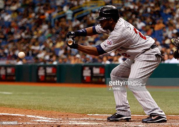 Outfielder Denard Span of the Minnesota Twins bunts against the Tampa Bay Rays during the game at Tropicana Field on May 31 2009 in St Petersburg...