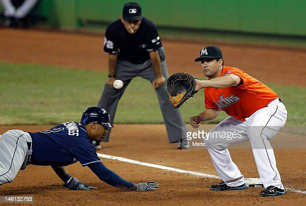 Outfielder Desmond Jennings of the Tampa Bay Rays gets back safely to first as Gaby Sanchez of the Miami Marlins takes the throw during the game at...