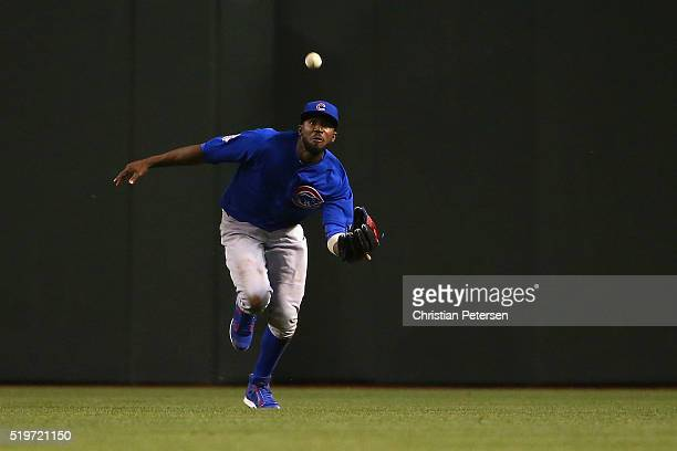 Outfielder Dexter Fowler of the Chicago Cubs makes a running catch during the third inning of the MLB game against the Arizona Diamondbacks at Chase...