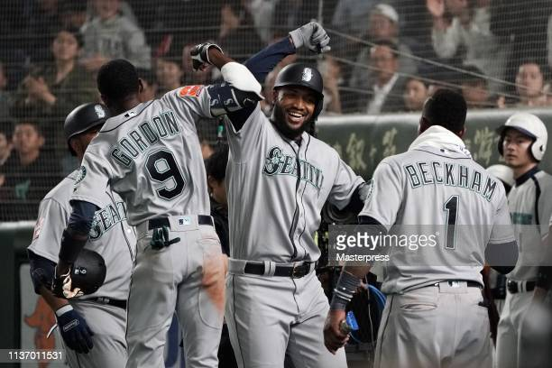 Outfielder Domingo Santana of the Seattle Mariners celebrates hitting a grand slam to make it 52 with his team mates in the 3rd inning during the...