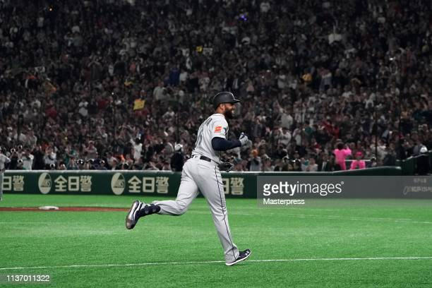 Outfielder Domingo Santana of the Seattle Mariners celebrates after hitting a grand slam to make it 52 in the 3rd inning during the game between...