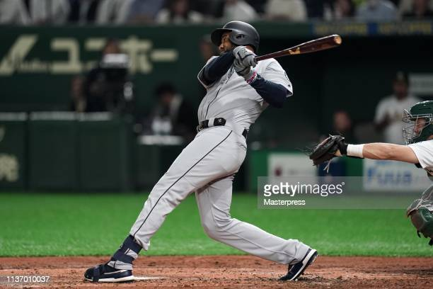 Outfielder Domingo Santana of the Seattle Mariners hits a grand slam to make it 52 in the 3rd inning during the game between Seattle Mariners and...