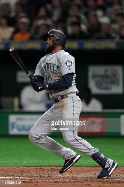 Outfielder Domingo Santana of the Seattle Mariners hits a single in the top of 7th inning during the game between the Yomiuri Giants and Seattle...